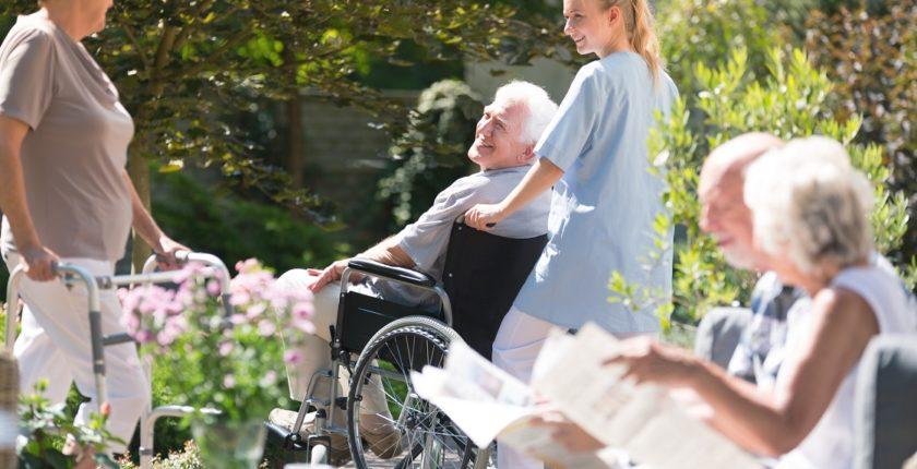 Nurse supporting senior man